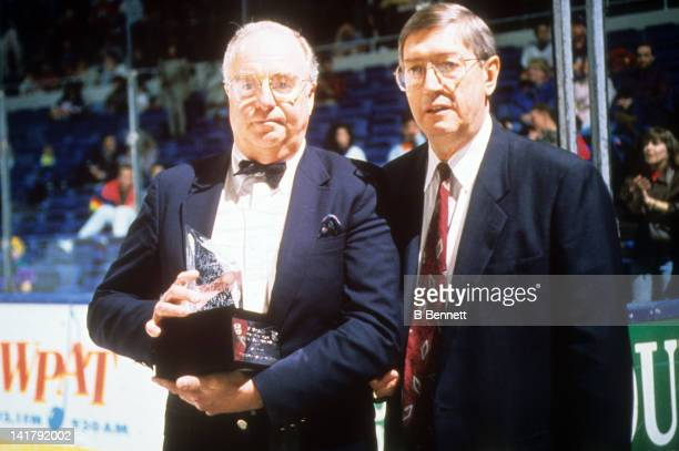 Bill Torrey and Al Arbour pose with a trophy before an New York Islanders game in April 1992 at the Nassau Coliseum in Uniondale New York
