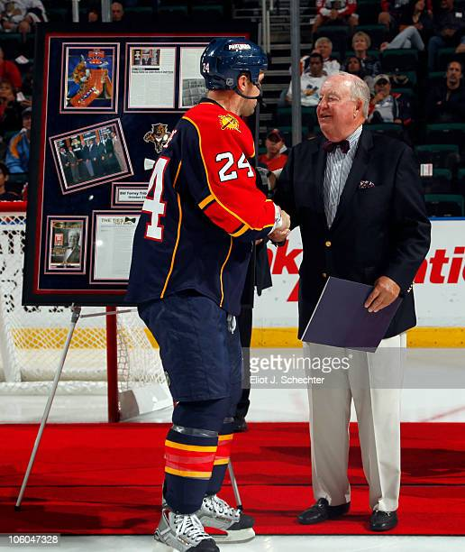 Bill Torrey shakes hands Bryan McCabe of the Florida Panthers during a tribute honoring Bill Torrey as the Florida Panthers play host to the New York...