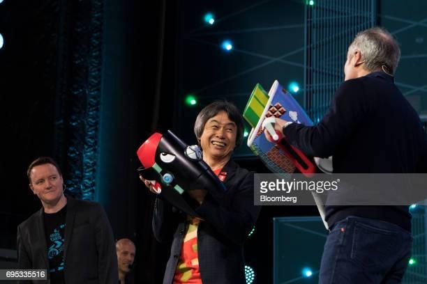 Bill Trinen director of product marketing of Nintendo of America Inc from left Shigeru Miyamoto representative director and creative fellow at...