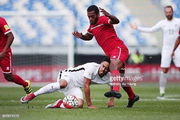 Bill Tuiloma of New Zealand competes against Joel Wakanumune of New Caledonia during the 2018 FIFA World Cup Qualifier match between the New Zealand...