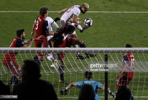 Bill Tuiloma of Portland Timbers takes a shot against Jesse Gonzalez of FC Dallas in the second half at Toyota Stadium on April 13 2019 in Frisco...