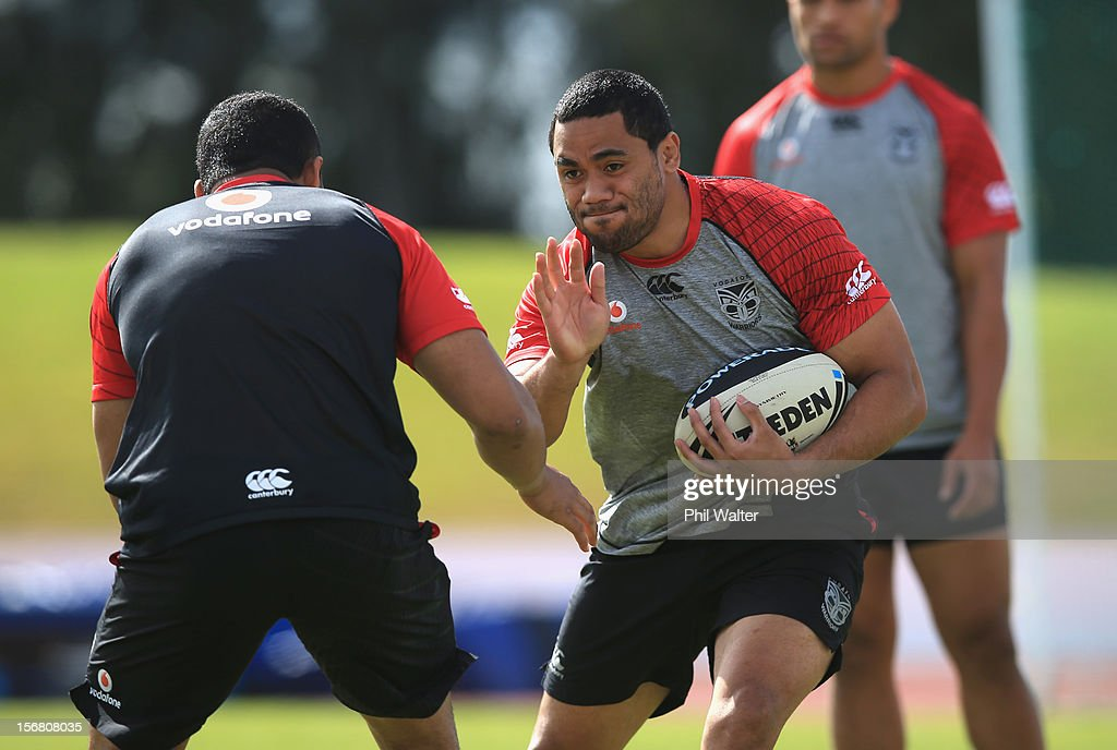 Bill Tupou of the Warriors fends during a New Zealand Warriors NRL pre-season training session at the Millenium Institute on November 22, 2012 in Auckland, New Zealand.