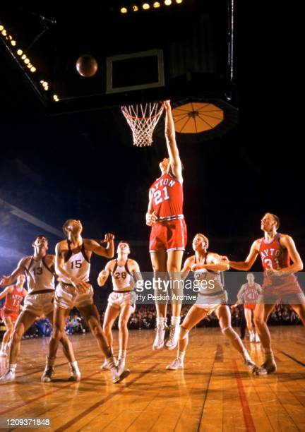 Bill Uhl of the Dayton Flyers goes for the rebound during an NCAA game against the Iona Gaels on January 7, 1956 at Madison Square Garden in New...