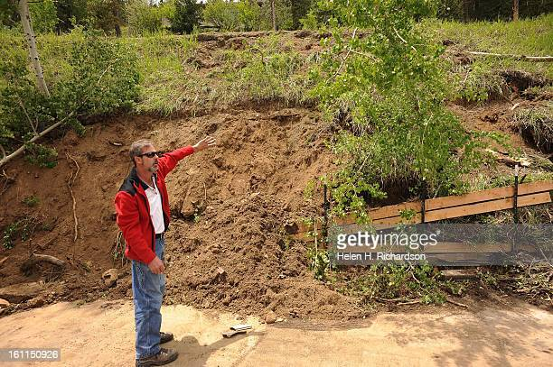 Bill Vickery shows the area where the Evergreen firetruck came down the hillside above his driveway. Bill Vickery bought his 1969 Pontiac Firebird in...