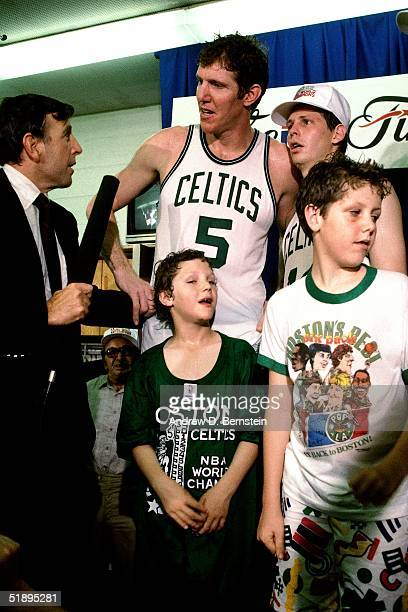 Bill Walton and Danny Ainge of the Boston Celtics are interviewed by sportscaster Brent Musburger after winning the 1987 NBA Championship against the...