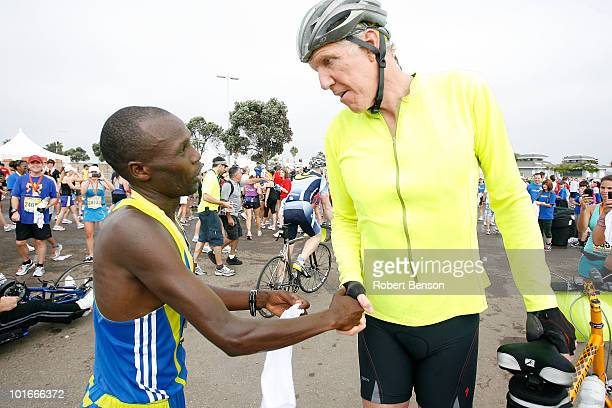 Bill Walton congratulates the winner of the 13th Annual Rock n' Roll Marathon Nicolas Arciniaga on June 6 2010 in San Diego California