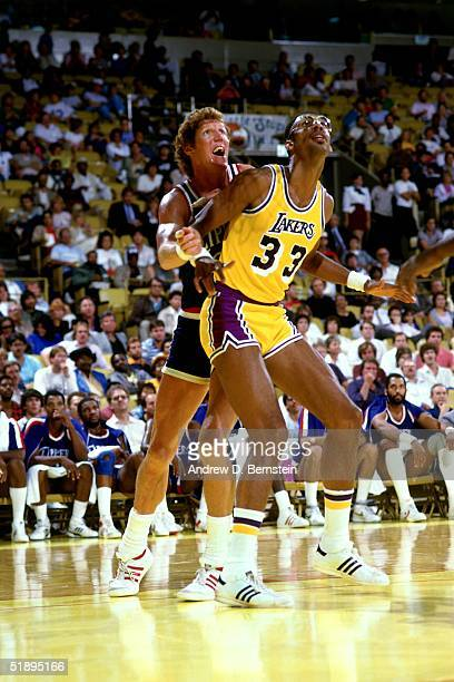Bill Walton of the Boston Celtics battles for position with Kareem AbdulJabbar of the Los Angeles Lakers during the NBA game at the Forum in Los...