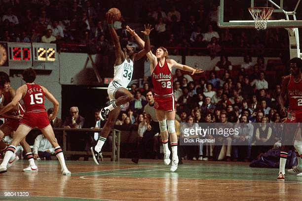Bill Walton of the Portland Trail Blazers blocks a shot attempt by Bob Bigelow of the Boston Celtics during a game played in 1977 at the Boston...