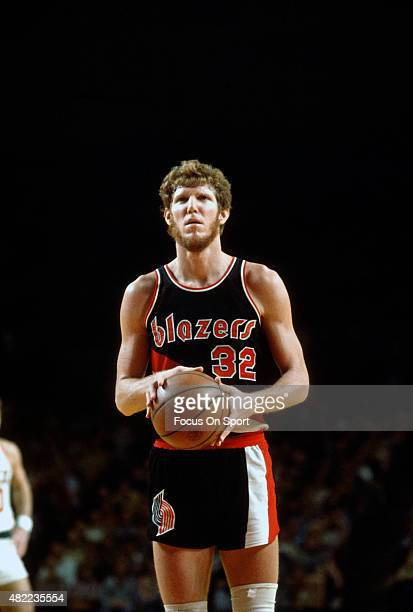 Bill Walton of the Portland Trail Blazers looks to shoot a free throw against the Milwaukee Bucks during an NBA basketball game circa 1977 at the...