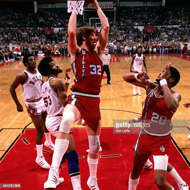 Bill Walton of the Portland Trail Blazers rebounds against the Chicago Bulls during a game played circa 1972 at Chicago Stadium in Chicago Illinois...