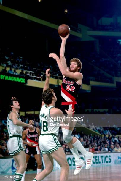 Bill Walton of the Portland Trail Blazers shoots over Dave Cowens of the Boston Celtics during a game played circa 1977 at the Boston Garden in...