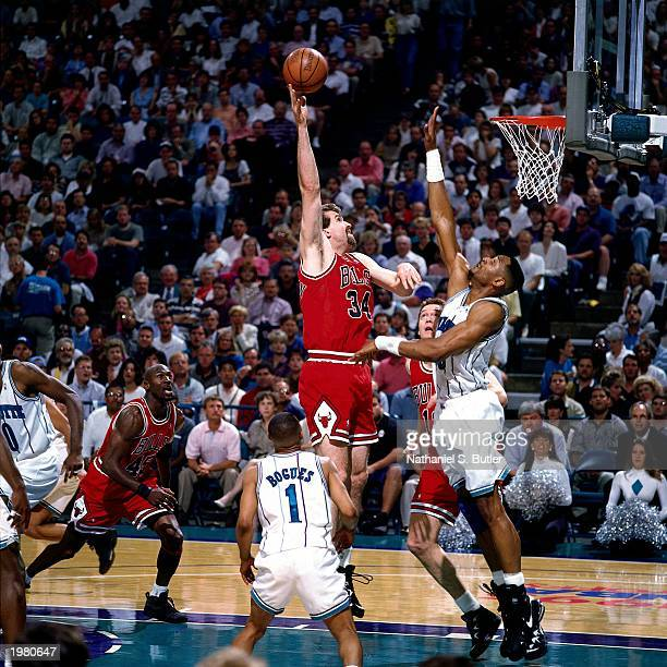 Bill Wennington of the Chicago Bulls goes up against Alonzo Mourning of the Charlotte Hornets in Game one of the Eastern Conference Quarterfinals...