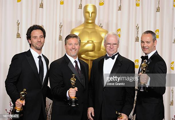 Bill Westenhofer, Guillaume Rocheron, Erik-Jan De Boer and Donald R. Elliott pose in the press room during the Oscars at the Loews Hollywood Hotel on...