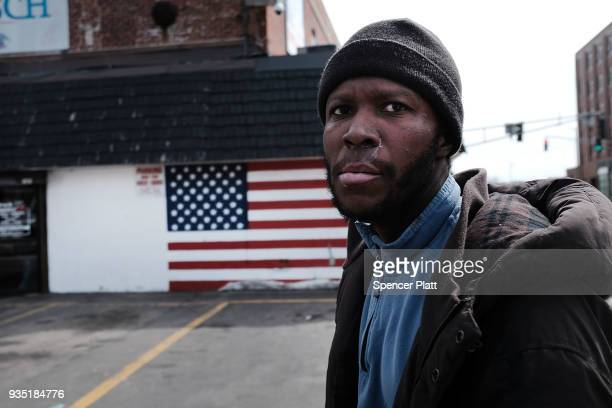 Bill who is a military veteran and now homeless walks through an economically stressed section of the city on March 20 2018 in Worcester...