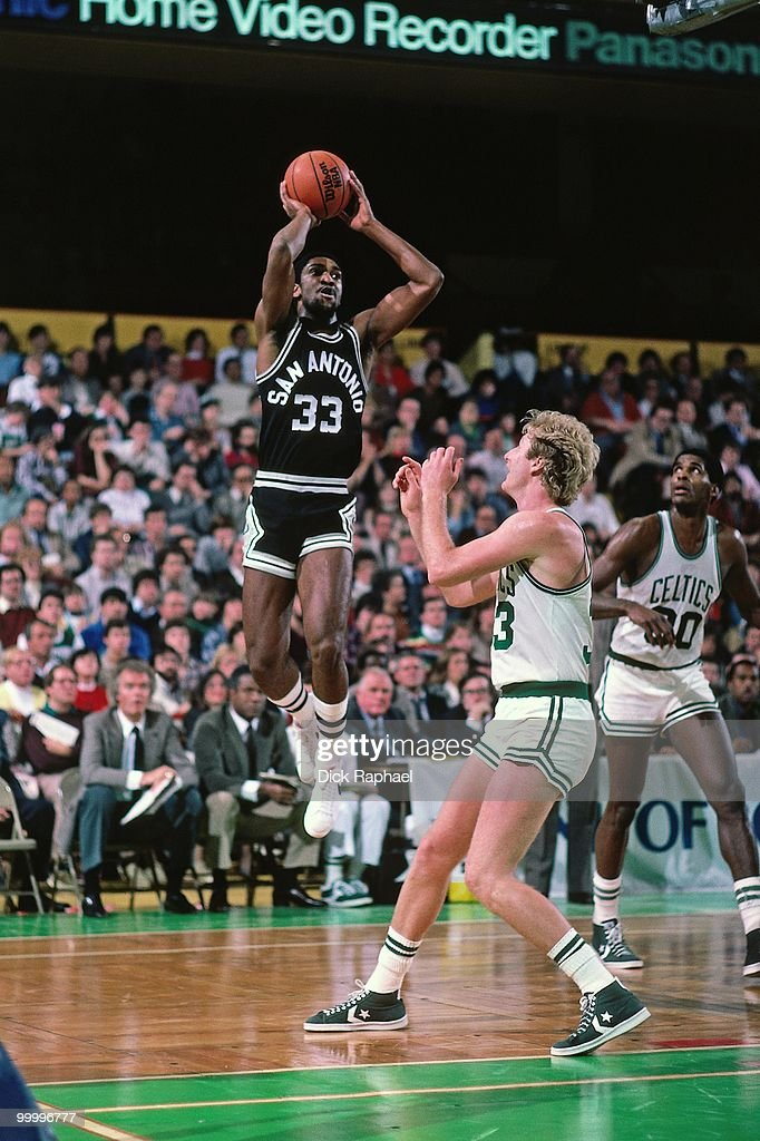 Bill Willoughby #33 of the San Antonio Spurs shoots a jumper against Larry Bird #33 of the Boston Celtics during a game played in 1983 at the Boston Garden in Boston, Massachusetts.