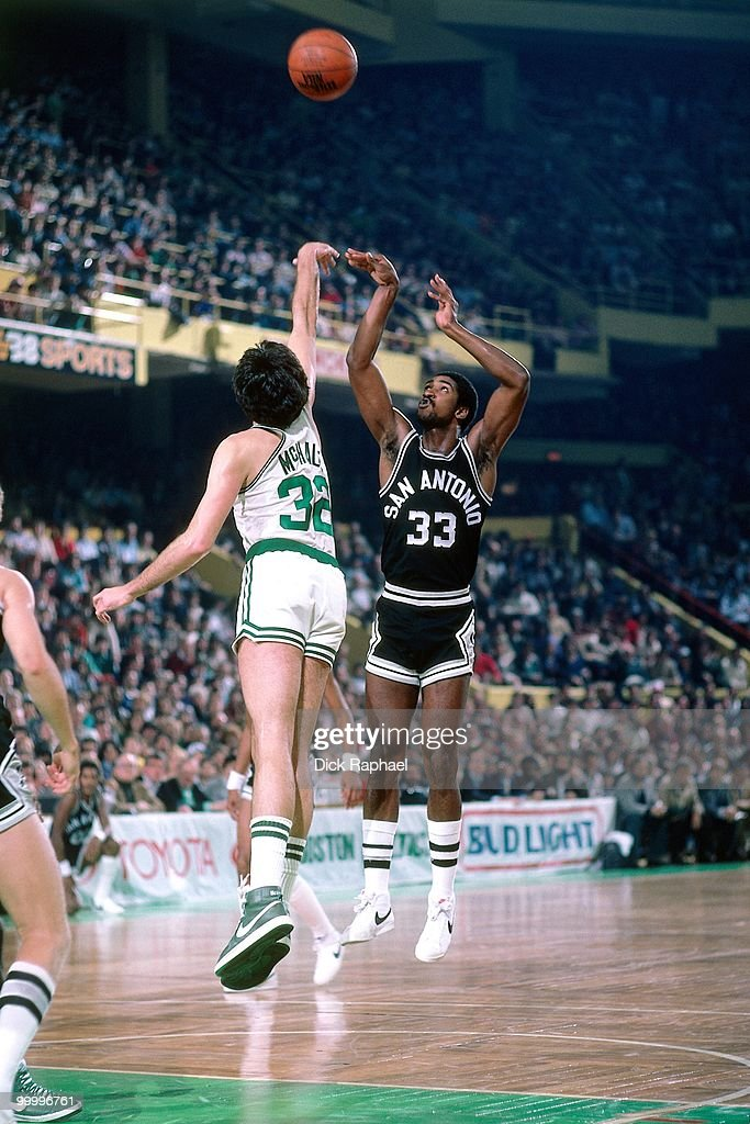 Bill Willoughby #33 of the San Antonio Spurs shoots over Kevin McHale #32 of the Boston Celtics during a game played in 1983 at the Boston Garden in Boston, Massachusetts.