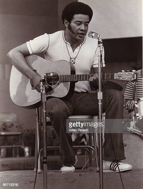 Bill Withers performs on stage in 1972