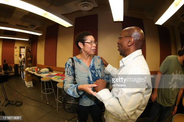 Bill Wither's wife Marcia Johnson and Musical Director Greg Phillinganes speak while the house band rehearses for the Lean On Him A Tribute To Bill...