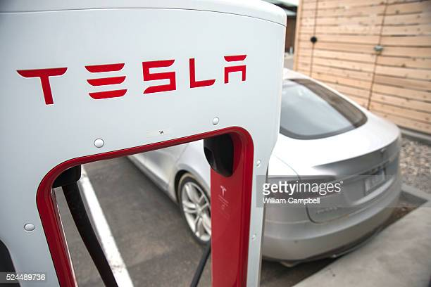 Bill Woodhouse from Power Montana charges his Tesla P85D at the Telsa Supercharger station in Big Timber Montana There are 6 Tesla Supercharger...