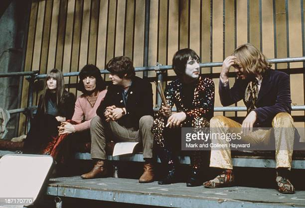 Bill Wyman and Brian Jones from The Rolling Stones sit with Keith Moon from The Who on the set of the Rolling Stones Rock and Roll Circus at Intertel...