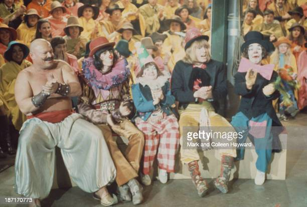 Bill Wyman and Brian Jones from The Rolling Stones with various clowns and entertainers on the set of the Rolling Stones Rock and Roll Circus at...