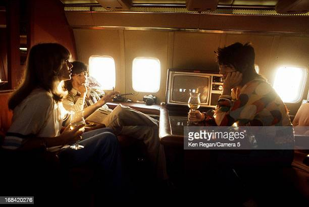Bill Wyman and Ronnie Wood of the Rolling Stones are photographed on their private plane in 1975 in Kansas City Kansas CREDIT MUST READ Ken...