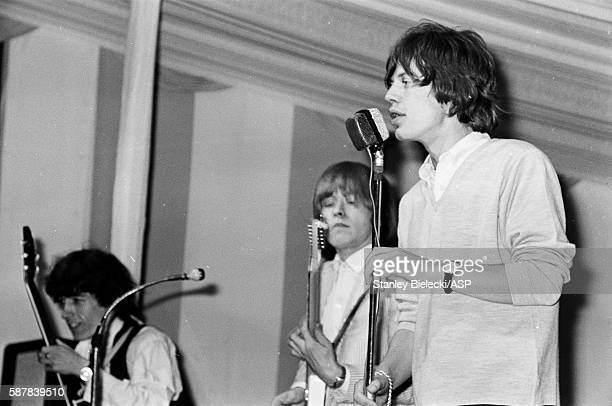 Bill Wyman Brian Jones and Mick Jagger of The Rolling Stones perform on stage at the Fourth National Richmond Jazz Blues Festival United Kingdom 7th...