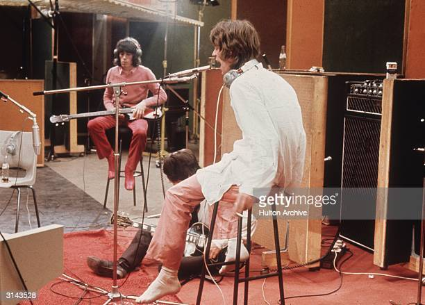 Bill Wyman Keith Richards and Mick Jagger of the Rolling Stones recording their hit 'Sympathy For The Devil'