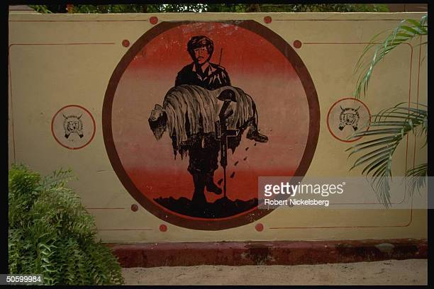 LTTE billbd imaging fighter carrying fallen comrade flanked by logo of Tamil separatist Liberation Tigers of Tamil Eelam movement