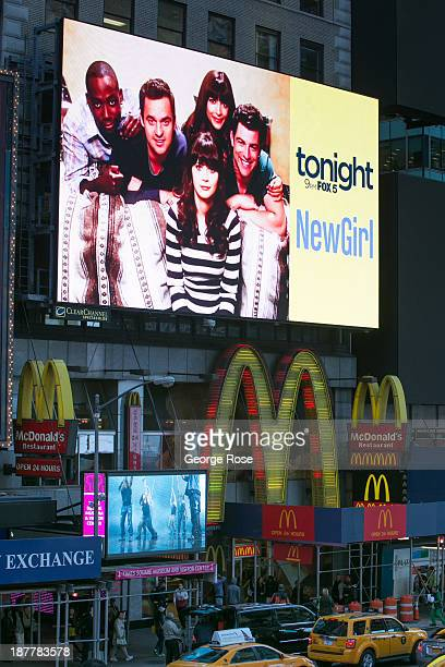 A billboard above a McDonald's in Times Square promotes Fox TV's 'New Girl' on October 23 2013 in New York City With a full schedule of conventions...