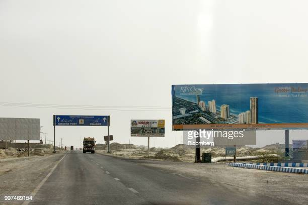 A billboard advertisement for a housing development stands along a highway on the outskirts of Gwadar Balochistan Pakistan on Monday July 3 2018 What...