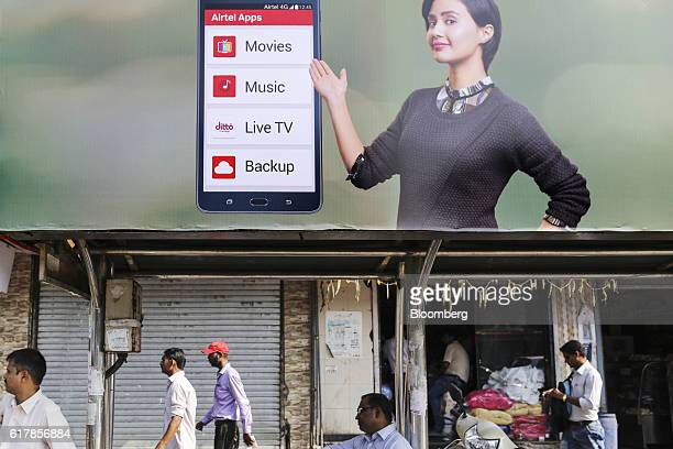 A billboard advertisement for Bharti Airtel Ltd is displayed above a bus stop in Mumbai India on Monday Oct 24 2016 Bharti Airtel is scheduled to...
