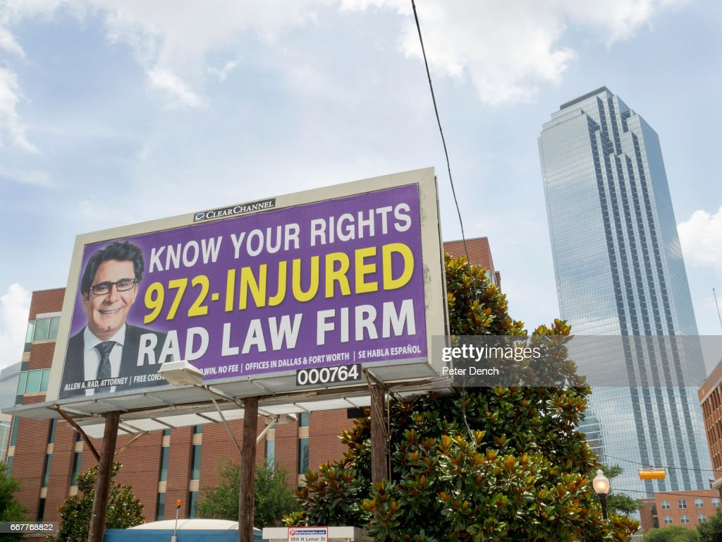 A billboard advertisement for RAD LAW FIRM on display in downtown