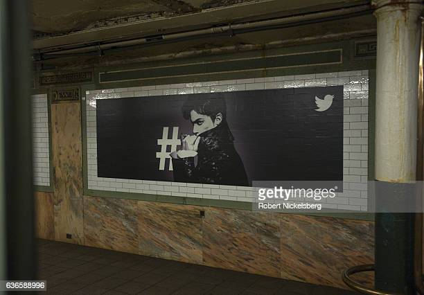 A billboard advertisement for Twitter displaying a portrait of former recording artist Prince hangs from a wall December 13 2016 in a subway station...
