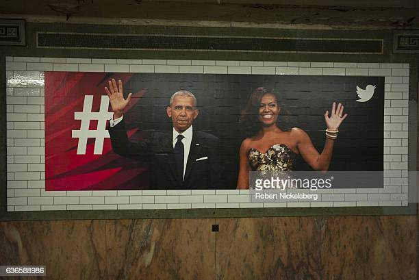 A billboard advertisement for Twitter displays the faces of President Barack Obama and his wife Michelle Obama on a wall December 12 2016 in a subway...