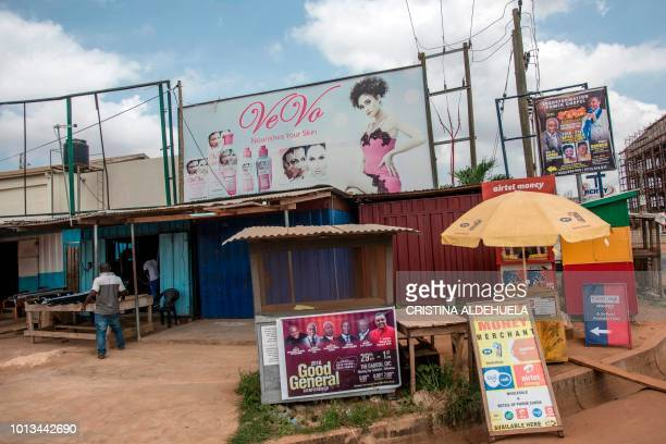 A billboard advertises clarifying body lotions clarifying soaps and others skinlightening products on Spintex Road in Accra on July 2 2018 Africa is...