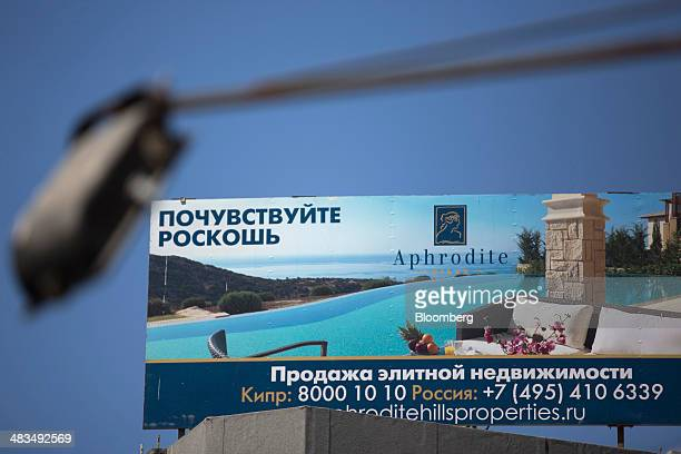 A billboard advertises luxury property for sale in Russian cyrillic script in Limassol Cyprus on Tuesday April 8 2014 Cyprus wants to shield...