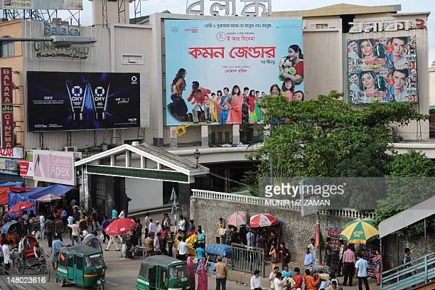 A billboard advertises the film Common Gender at a movie theatre in Dhaka on July 6 2012 A film about a love affair between a transgender person and...