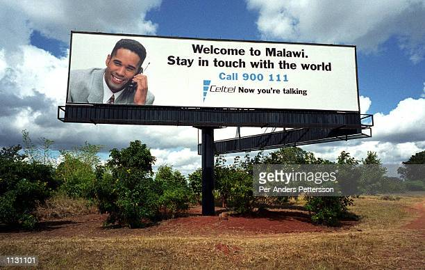 A billboard advertising Celtel a mobile phone carrier is shown June 13 2002 in Lilongwe Malawi Mobile phone sales are booming in Africa because of a...