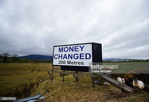 A billboard advertising pounds sterling to euros money changing services can be seen on May 1 2016 in Newry Northern Ireland The billboard is...