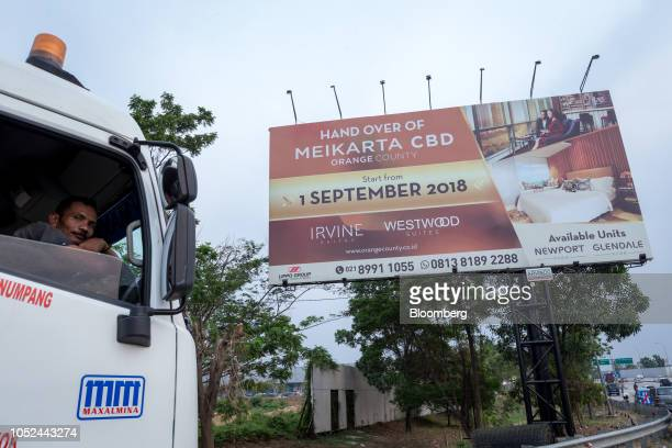 A billboard advertising residential apartments stands at the under construction Meikarta project developed by Lippo Group in Bekasi Regency West Java...