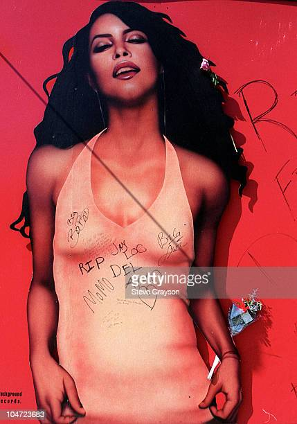 A billboard advertising the latest release Aaliyah is adorned with flowers and condolences from fans The singer along with 8 others died in a plane...