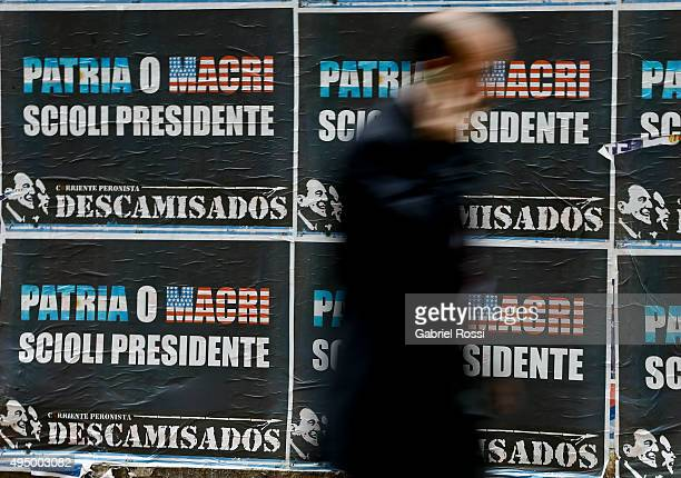 A billboard against Mauricio Macri is seen during the election campaign period on October 30 2015 in Buenos Aires Argentina Elections runoff between...