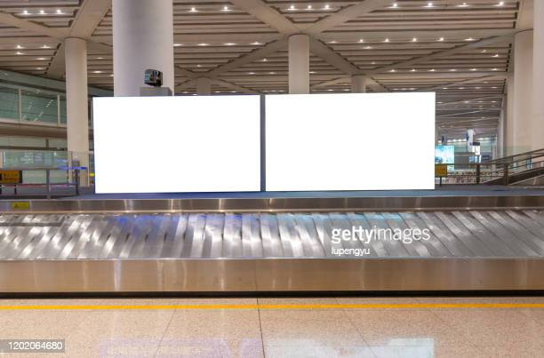 billboard at baggage claim - transport stock pictures, royalty-free photos & images