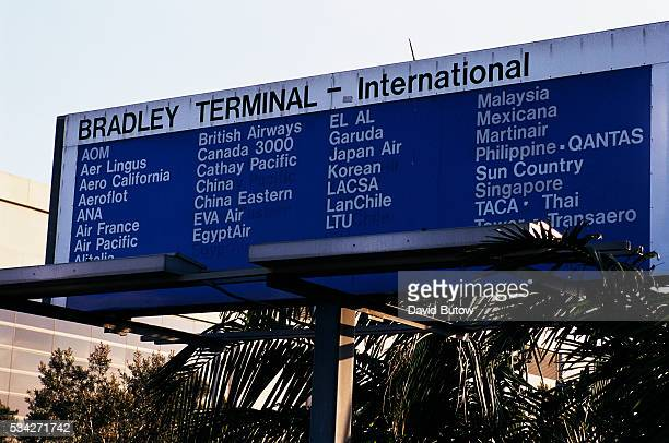 A billboard at Los Angeles International Airport lists the international flights at Bradley Terminal