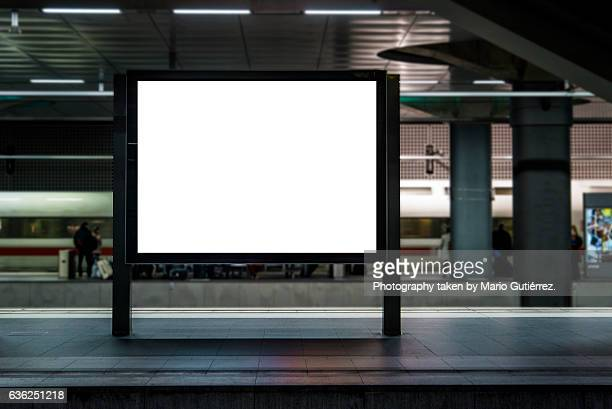 billboard at station - placard stock pictures, royalty-free photos & images