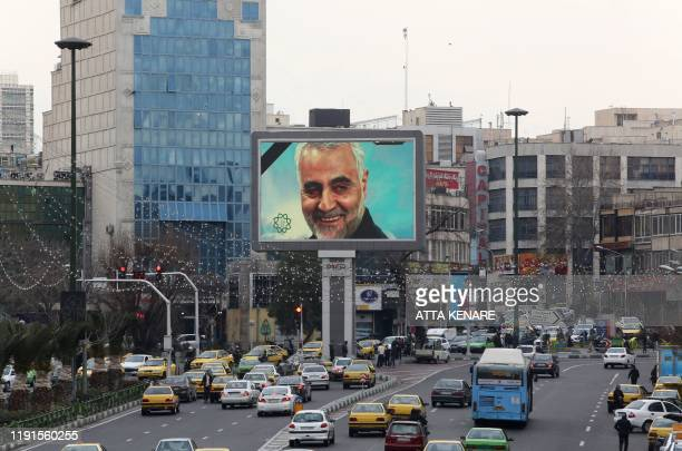 A billboard bearing a portrait with the black mourning ribbon of slain Iranian military commander Qasem Soleimani the deputy commander of the...