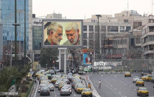 A billboard bearing a portrait with the black mourning ribbon of slain Iranian military commander Qasem Soleimani and Iraqi paramilitary chief Abu...