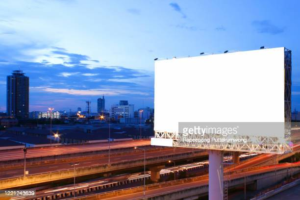 billboard blank for outdoor advertising poster on the highway - billboard highway stock pictures, royalty-free photos & images