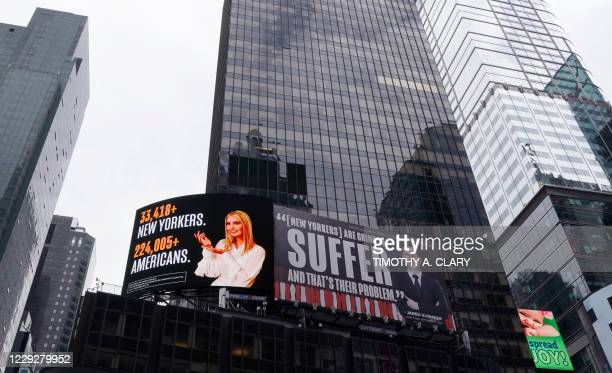 TOPSHOT A billboard by The Lincoln Project is seen in Times Square on October 25 2020 in New York depicting Ivanka Trump presenting the number of New...